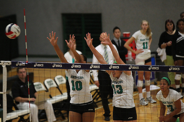 Denton, TX - OCTOBER 7: Karissa Flack #10 and Hallie McDonald #13 of the University of North Texas Mean Green Volleyball in action against the Middle Tennessee at University of North Texas Volleyball Complex in Denton on October 7, 2012 in Denton, Texas. (Photo by Rick Yeatts)