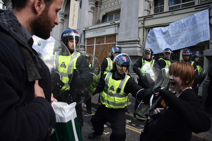 A Protester gets pushed aggressively by one of the police at the G20 Demonstration in London.