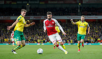 Olivier Giroud of Arsenal takes on Christoph Zimmermann (left) of Norwich City during the Carabao Cup match between Arsenal and Norwich City at the Emirates Stadium, London, England on 24 October 2017. Photo by Carlton Myrie.