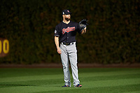 Cleveland Indians Corey Kluber (28) warms up in the outfield before Game 4 of the Major League Baseball World Series against the Chicago Cubs on October 29, 2016 at Wrigley Field in Chicago, Illinois.  (Mike Janes/Four Seam Images)