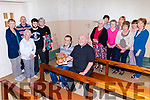 Fr Kevin McNamara, from The Church of the Assumption Moyvane, pictured with Stephen Stack (seated) and locals, who are busy organising a Phil Coulter concert with proceeds going towards the complete repainting of the church which has been damaged with dampness over the years.