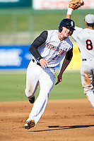 Trey Michalczewski (27) of the Kannapolis Intimidators hustles towards third base against the Hickory Crawdads at CMC-Northeast Stadium on May 4, 2014 in Kannapolis, North Carolina.  The Intimidators defeated the Crawdads 3-1.  (Brian Westerholt/Four Seam Images)