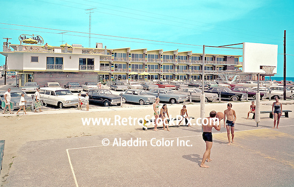 Attache Motel in Wildwood New Jersey. Teenagers playing on the Basketball court across the street from the motel. 1960's photograph.