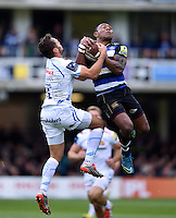 Semesa Rokoduguni of Bath Rugby competes with Phil Dollman of Exeter Chiefs for the ball in the air. Aviva Premiership match, between Bath Rugby and Exeter Chiefs on October 17, 2015 at the Recreation Ground in Bath, England. Photo by: Patrick Khachfe / Onside Images
