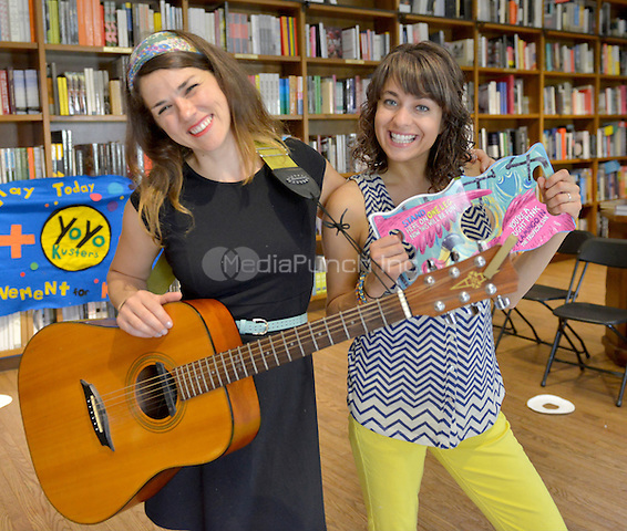 CORAL GABLES, FL - JUNE 09: Lolly Hopwood and Yvonne Kusters of Lolly & YoYo signs copies of thier book 'Move'' at Books and Books on June 9, 2016 in Coral Gables, Florida.  Credit: MPI10 / MediaPunch