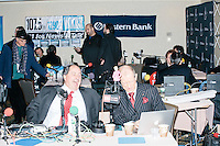 Radio journalists wait for political guests to arrive for interviews at the Radisson Hotel's Radio Row in Manchester, New Hampshire, on Mon., Feb. 8, 2016. Many television and radio stations set up in the hotel for their coverage of the primary in the final days of the campaign.