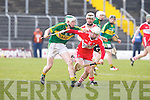Kerry's Daniel Collins tries to push passed Derry's Paddy Henry at Austin Stack park, Tralee on Sunday.