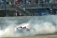 11 September, 2005, Joliet,IL,USA<br /> Winner Dan Wheldon does a victory burnout.<br /> Copyright&copy;F.Peirce Williams 2005