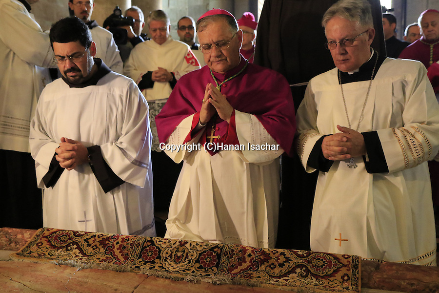 Israel, the Latin Patriarch of Jerusalem Fouad Twal prays by the Stone of Anointing at the Church of the Holy Sepulchre on Easter Sunday