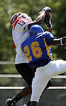 MADISON, SD - AUGUST 30: Anthony Saincilaire of Bacone College catches a touchdown pass over Brandon Crawford of Dakota State University in the first quarter of their game Saturday afternoon at Trojan Field in Madison. (photo by Dave Eggen/Inertia)