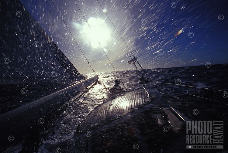 "Sailing yacht ""Heron"", water spraying over deck in rough ocean, off Oahu, Hawaii during a storm"