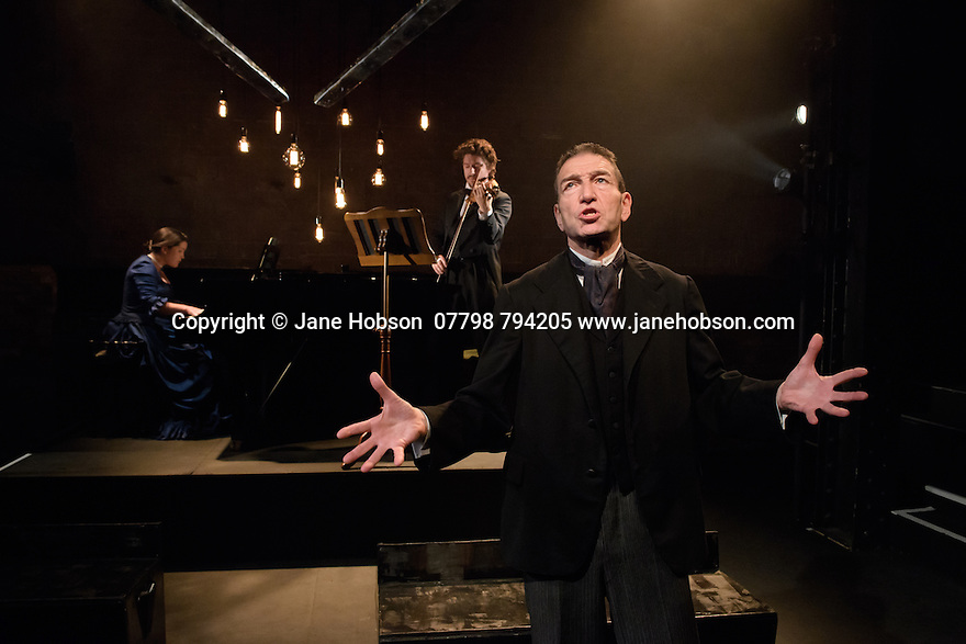 London, UK. 11.07.2016. The Arcola Theatre presents The Theatre Chipping Norton's production of THE KREUTZER SONATA, by Leo Tolstoy, adapted by Nancy Harris. Directed by John Terry, with lighting design by Alexndra Stafford and set and costume design by Alex Berry. Greg Hicks stars as Pozdnyshev. Picture shows: Greg Hicks (Pozdnyshev), Alice Pinto (piano), Phillip Granell (Violin). Photograph © Jane Hobson.