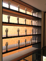 Shelves filled with a collection of porcelain hands line the window of the upstairs sitting room