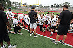 Redondo Beach, CA 10/14/10 - Coach Chris Artino addresses the team at half time in action during the Peninsula vs Redondo Junior Varsity football game at Redondo Union HIgh School.