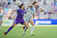 Orlando, FL - Sunday May 14, 2017: Marta, Ashley Hatch during a regular season National Women's Soccer League (NWSL) match between the Orlando Pride and the North Carolina Courage at Orlando City Stadium.