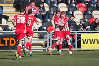 Josh Windass of Accrington Stanley (second right) celebrates scoring his side's second goal with Brad Halliday during the Sky Bet League 2 match between Newport County and Accrington Stanley at Rodney Parade, Newport, Wales on 28 March 2016. Photo by Mark  Hawkins.