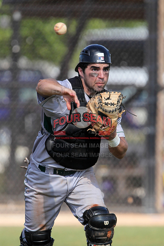 Slippery Rock catcher Matt Accardi #15 throws to first during a game against the Winona State Warriors at Lake Myrtle Complex on March 15, 2012 in Auburndale, Florida.  Winona defeated Slippery Rock 10-3.  (Mike Janes/Four Seam Images)