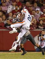 Hawgs Illustrated/BEN GOFF <br /> Henre' Toliver, Arkansas cornerback, tackles Kerryon Johnson, Auburn running back, in the first quarter Saturday, Oct. 21, 2017, at Reynolds Razorbacks Stadium in Fayetteville.