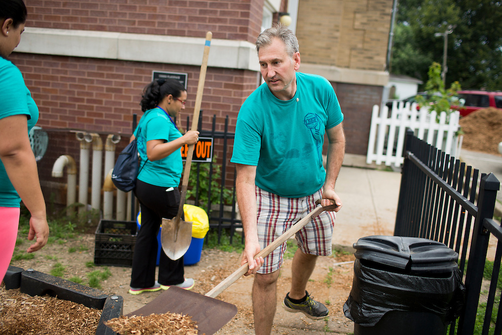 "Members work at the Hawthorne Center for Working Families during ""Circle the City with Service,"" the Kiwanis Circle K International's 2015 Large Scale Service Project, on Wednesday, June 24, 2015, in Indianapolis. (Photo by James Brosher)"