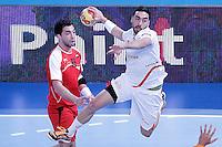 Egypt's Ahmed Mostafa (l) and Spain's Valero Rivera Folch during 23rd Men's Handball World Championship preliminary round match.January 14,2013. (ALTERPHOTOS/Acero) /NortePhoto