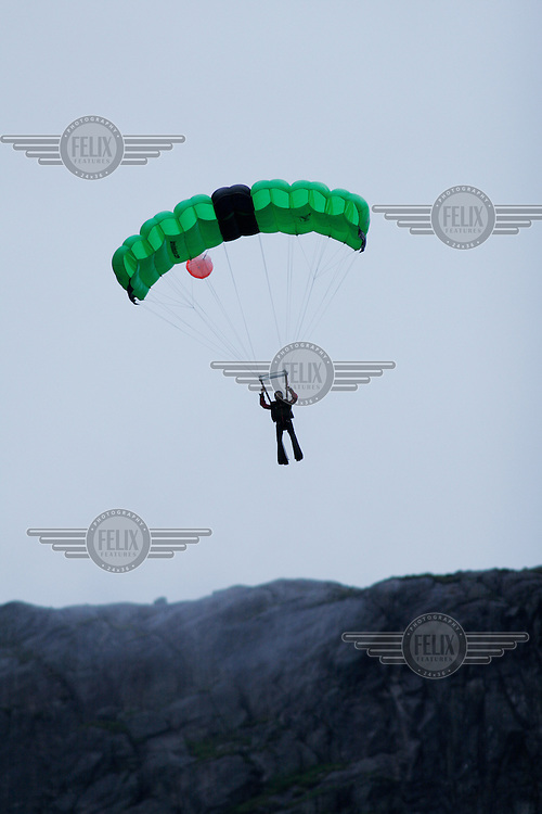 """Øyvind Løkeberg coming in to land after a jump at Kjerag. Kjerag in the Lysebotn fjord is popular with BASEjumpers, but considered fairly unchallanging by the wingsuit flyers of """"Verdal'n BASE and Karsk"""". © Fredrik Naumann"""