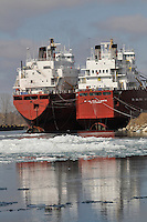 Ships tied up in the Port of Sarnia for winter maintenance, reflections and ice