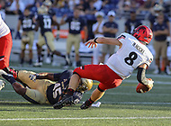Annapolis, MD - September 23, 2017: Navy Midshipmen linebacker D.J. Palmore (45) sacksCincinnati Bearcats quarterback Hayden Moore (8) during the game between Cincinnati and Navy at  Navy-Marine Corps Memorial Stadium in Annapolis, MD.   (Photo by Elliott Brown/Media Images International)