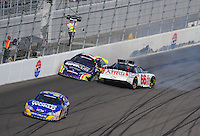 Mar 1, 2008; Las Vegas, NV, USA; Nascar Nationwide Series drivers Steve Wallace (66) and Mike Bliss (22) crash during the Sams Town 300 at the Las Vegas Motor Speedway. Mandatory Credit: Mark J. Rebilas-US PRESSWIRE