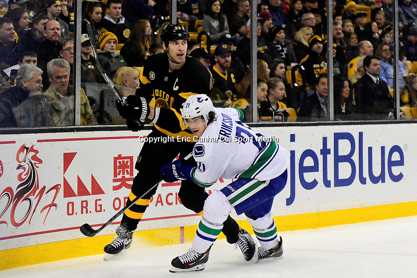 February 11, 2017: Boston Bruins defenseman Zdeno Chara (33) and Vancouver Canucks left wing Loui Eriksson (21) in game action during the National Hockey League game between the Vancouver Canucks and the Boston Bruins held at TD Garden, in Boston, Mass. Boston defeats Vancouver 4-3 in regulation time. Eric Canha/CSM