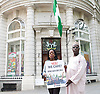 276 girls were seized from their school in the village of Chibok, in Borno state, north Nigeria, by Boko Haram militants, 53 managed to escape. It is feared that the remaining girls will be sold by the group. <br /> <br /> A group called &quot;Bring Back Our Girls,&quot; which is comprised of relatives of the missing students, have staged regular protests across Nigeria calling for the government and military to do more to find the girls. Currently 234 girls are still missing. This was the first London protest outside the Nigerian High Commission in Northumberland Avenue, London, United Kingdom. 5th May 2014. <br /> <br /> pictured are protestors and outside the High Commission door is: <br /> Lola Bello - who leads a charity to educate Nigerian children in the UK called Path to Possibilities based in Trent Park, Enfield, EN4 0PS info@pathtopossibilities.co.uk www.pathtopossibilities.co.uk <br />  <br /> with Mohammed Usman who comes from the region where the girls disappeared  from.