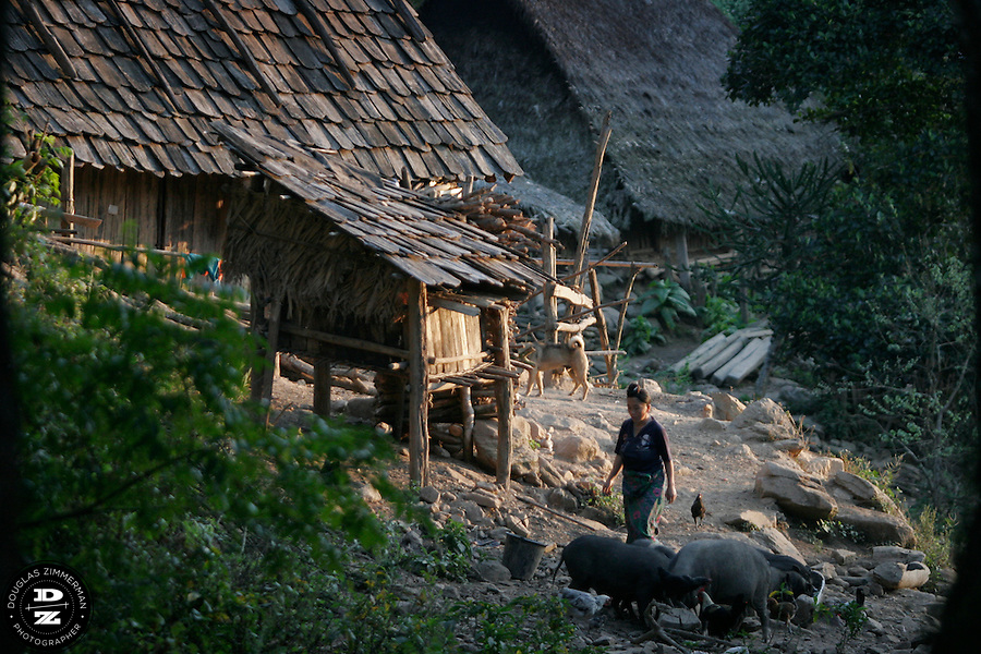 A lady walks through the village of Sam Yord, in the county of Louang Namtha,  Laos.  The remote village, only accessible on foot is a village of the Hmong ethnic group. Photograph by Douglas ZImmerman.