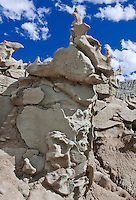 746000003 strange sandstone formations stand watch over the landscape in fantasy canyon a blm property in the middle of a working oil field in northeastern utah united states