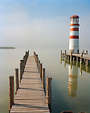 AUSTRIA, Podersdorf, a pier and a lighthouse in the fog, Lake Neusiedler See, Burgenland