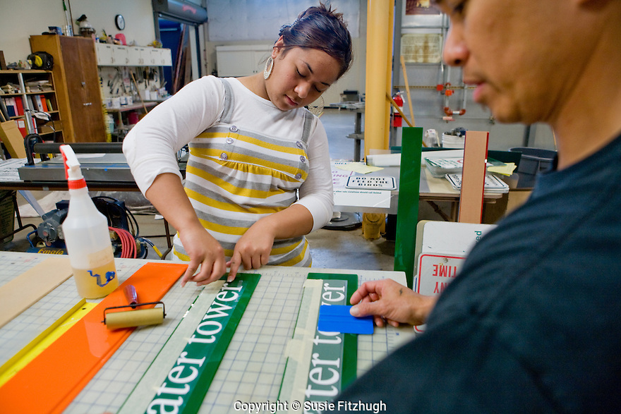 SPS Intern Stephanie Tuiasosopo,  a junior at Rainier Beach HS, works with Tracy Tyau, staff painter with the Seattle Department of Parks and Recreation.