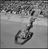 BNPS.co.uk (01202 558833)<br /> Pic: Aerofilms/HistoricEngland/BNPS<br /> <br /> In all its pomp - Brighton West Pier, 21 May 1952.<br /> <br /> Stunning historic aerial photos of seaside towns, naval bases, ports and shipyards which tell the story of Britain's once-great maritime tradition feature in a new book.<br /> <br /> The fascinating archive of black and white images includes views from a bygone age such as Brighton's famous West Pier, Grimsby's burgeoning fishing fleet, and London's dock yards.<br /> <br /> Iconic ships were also captured from the skies including the Cutty Sark in its final seaworthy years on the Thames, HMY Britannia in 1959, the RMS Queen Mary in 1946 and the SS Queen Elizabeth in 1969 about to make her maiden voyage.<br /> <br /> England's Maritime Heritage from the Air, by Peter Waller, is published by English Heritage and costs &pound;35.
