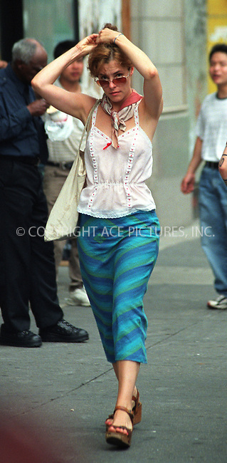 Actress Parker Posey spotted strolling up Sixth Avenue on a hot summer day in New York. June 26, 2002. Please byline: Alecsey Boldeskul/NY Photo Press.   ..*PAY-PER-USE*      ....NY Photo Press:  ..phone (646) 267-6913;   ..e-mail: info@nyphotopress.com