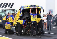 Jun. 2, 2013; Englishtown, NJ, USA: NHRA crew members work under the body for funny car driver Matt Hagan during the Summer Nationals at Raceway Park. Mandatory Credit: Mark J. Rebilas-