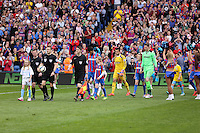 Pictured: Match officials lead the teams onto the pitch<br />
