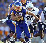 BROOKINGS, SD - AUGUST 31:  Zach Zenner #31 from South Dakota State University breaks loose for a big gain on the opening drive past Kyle Annis #90 from Butler in the first quarter Saturday evening at Coughlin Alumni Stadium in Brookings. (Photo by Dave Eggen/Inertia)