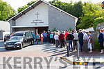 People line up to pay respects to the late Murt O'Shea at O'Shea's funeral home on Wednesday evening