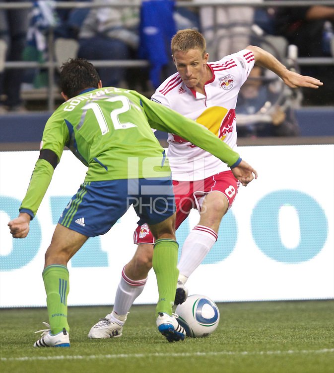 New York Red Bulls forward Jan Gunnar Solli tries to dribble pas Seattle Sounders FC defender Leonardo Gonzalez  during play Qwest Field in Seattle Saturday June 23, 2011. The Sounders won the game 4-2.