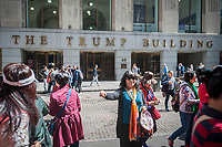 Hordes of Asian tourists amuse themselves in front of the Trump building at 40 Wall Street in New York on Thursday, April 27, 2017.  (© Richard B. Levine)