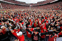 Ohio State Buckeyes fans sing Carmen Ohio after the Buckeyes 30-27 double overtime win over Michigan Wolverines at Ohio Stadium in Columbus, Ohio on November 26, 2016.  (Kyle Robertson / The Columbus Dispatch)