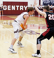 Westside Eagle Observer/RANDY MOLL<br /> Gentry senior Blake Wilkinson looks for an open teammate during play against Pea Ridge in Gentry on Friday, Jan. 31, 2020.