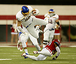 VERMILLION, SD - NOVEMBER 18: Dallas Goedert #86 from South Dakota State University is upended by Isaac Armstead #29 from the University of South Dakota during their game Saturday afternoon at the DakotaDome in Vermillion. (Photo by Dave Eggen/Inertia)