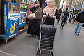Women shopping in Whitechapel Market, London.