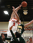 Douglas' Nick Maestretti and Bryce Hallam, with Manogue, battle for a rebound during a boys basketball game between Bishop Manogue and Douglas High in Minden, Nev., on Thursday, Dec. 22, 2011..Photo by Cathleen Allison