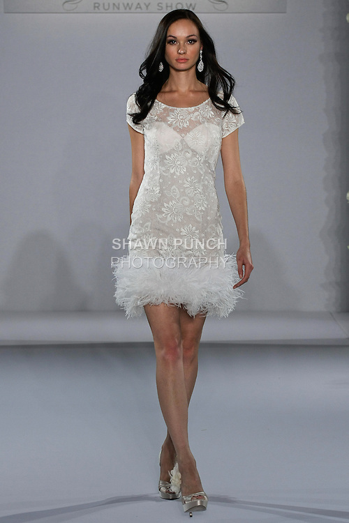 Model walks runway in a Sydney wedding dress from the Melanie Harris bridal collection, for the Couture Runway Show, during New York Bridal Fashion Week at The Hilton Hotel, October 13, 2012.