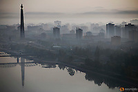The 170-metre (558-feet) tall Juche Tower is reflected in Taedong River as morning fog blankets Pyongyang, North Korea May 5, 2016.  REUTERS/Damir Sagolj
