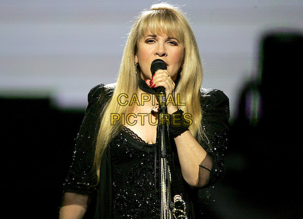 "STEVIE NICKS.Performs live for a four night production called ""Dreams"" exclusively at The Colosseum in Caesars Palace in Las Vegas, Nevada .May 11th, 2005.half length stage concert live gig performance singing.www.capitalpictures.com.sales@capitalpictures.com.Supplied By Capital PIctures"